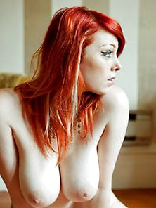 Sweet Redhead Babe Shows Off Her Tits