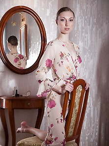 Floral Get-Up Hottie Looks At Her Own Reflection Before Strippin