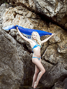 Gorgeous Blonde In A Barely-There Blue Bikini Strips Naked On Th