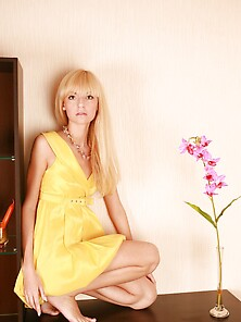 Blond-Haired Beauty In Yellow Showing Her Skinny Body After Undr